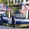 Ozark Center's Veteran Integration Program float make its way down the parade route during the  32nd Annual Community Veterans Day Parade on Saturday in downtown Joplin.<br /> Globe | Laurie SIsk