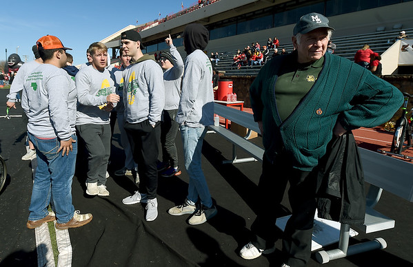 Members of Missouri Southern's Kappa Alpha fraternity gather with MSSU professor Conrad Gubera, right,  after the 2019 Pigskin run at Carnie Smith Stadium before the start of the Pittsburg State/MSSU football game. Gubera, who has taught at both PSU and MSSU, was a participant in the first pigskin run 45 years ago.<br /> Globe | Laurie SIsk