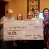 (from left) Soroptimist members Shelly Goerz, Karen McGlamery and Janet Taylor, Eileen Nichols with Webb City Farmers Market, and Sarah Alumbaugh, soroptimist president celebrate the donation of $2,000 from Soroptimist International of Joplin to the Webb City Farmers Market on Nov. 21 during their meeting at Mythos Euro Greek Kuzina. The donation will be used to fund the WIC voucher program which allows women currently active in the Women Infants and Children program to buy fresh fruits, vegetables, eggs, and meats at the Webb City Farmers Market.<br /> Photo Courtesy Soroptimist International of Joplin