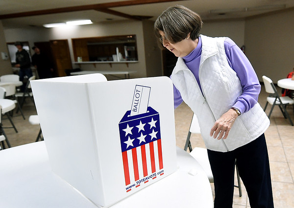 Election official Ruth Alexander checks voting booths for pens on Tuesday at Calvary NBaptist Church. Election officials reported a good turnout for an off-year election.<br /> Globe | Laurie Sisk
