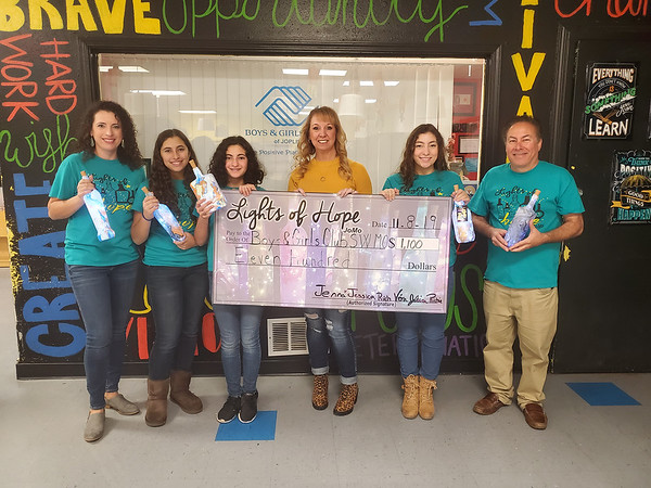 On Nov. 8, members of Lights of Hope, from left, Vera Joseph, Jessica Joseph, Jenna Joseph, Juliana Joseph and Richard Joesph give a check to Rhonda Gorham, executive director of the Boys & Girls Club of Southwest Missouri, center, from a fundraiser held by Lights of Hope. Several businesses helped by displaying and selling Lights of Hope.  These businesses include: Club 1201, Kraft Insurance Services, Don Gould Agency, Dr. Michael Patterson, DDS, Kyle Hickam State Farm Agent, and The Brace Place.<br /> Photo Courtesy Boys & Girls Club of Southwest Missouri