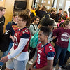 Joplin High football players Isaiah Davis, senior, left, and Dominick Simmons, junior, walk through the school during a parade on Tuesday.<br /> Globe | Roger Nomer