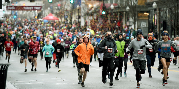 About 1,400 runners make their way down the course during the 8th Annual Joplin Turkey Trot on Satuday in downtown Joplin.<br /> Globe | Laurie Sisk