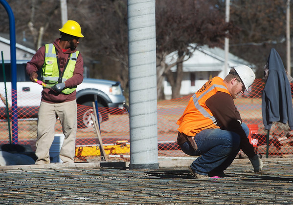 Nathaniel Simmons, a Pittsburg State University senior from Kansas City, Mo., left, and Brody Caster, a PSU senior from Douglas, Kan., prepare a foundation for concrete at Schlanger Park in Pittsburg on Monday.<br /> Globe | Roger Nomer