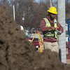 Nathaniel Simmons, a Pittsburg State University senior from Kansas City, Mo., prepares a foundation for concrete on Monday at Schlanger Park in Pittsburg.<br /> Globe | Roger Nomer