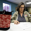 Voter Linda Ashby reads through Propostion B before casting her vote on Tuesday at First United Methodist Church.<br /> Globe | Laurie Sisk