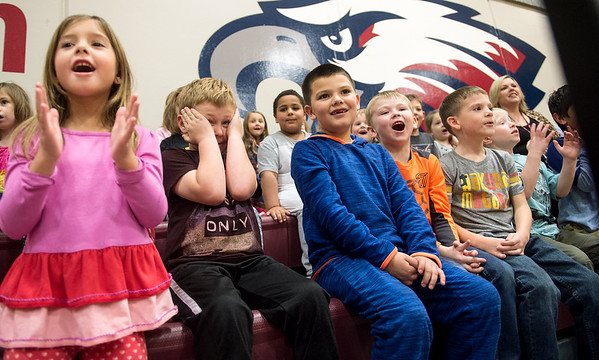 Kindergarten students at Cecil Floyd Elementary watch bicycle feats by the Stunt Dudes on Tuesday during a presentation for Joplin Schools All Kids Bike program.<br /> Globe | Roger Nomer