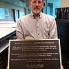 Steve Lawver, Carl Junction city administrator and Marine Corps veteran, holds up the bronze plaque that will soon be part of the Veteran Memorial in Memorial Park, 413 Pennell St. The project was initially predicted to be completed in time for Veteran's Day, but the date has been pushed back due to the weather.   Kimberly Barker/JoplinGlobe