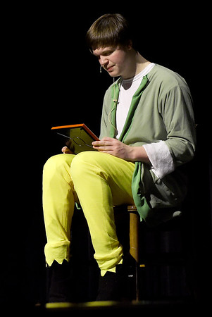"""Buddy the Elf, portrayed by Gavin Phillips, ponders his future during rehearsals for the Webb City High School production of """"Elf,"""" which opens Thursday night at WCHS. The cast and crew are collecting toys to benefit children.<br /> Globe 