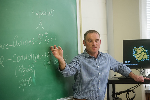 William Delehanty, associate professor of political science at Missouri Southern State University, teaches students in his American Government class about the impeachment process on Wednesday at MSSU.<br /> Globe | Roger Nomer