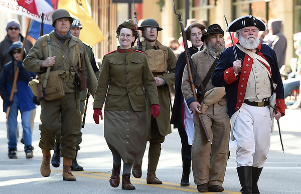 Reenactors pay homage to the service of men and women throughout the decades during the The 32nd Annual Community Veterans Day Parade on Saturday in downtown Joplin.<br /> Globe | Laurie SIsk