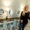 Courtney Coleman talks about the bride's dressing room at La Rose Blanche during an interview on Friday.<br /> Globe | Roger Nomer