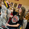 Hannah Trenary, freshman at Liberal High School, unwraps a new archery bow donated by the Missouri Department of Conservation on Wednesday at Liberal High School.<br /> Globe | Roger Nomer