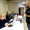 Trevor Keller, right, checks in with election official Phyllis Wilson, left, on Tuesday at Calvary Baptist Church. Officials at the precinct reported high voter turnout for an off-year election. Also pictured are election officials Darrel Smith and Karen Roberts.