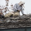 Jerimiah Donaldson, from Spring Hill, Fla., works on a roof at Royal Heights Baptist Church on Monday during an Americorps project.<br /> Globe | Roger Nomer