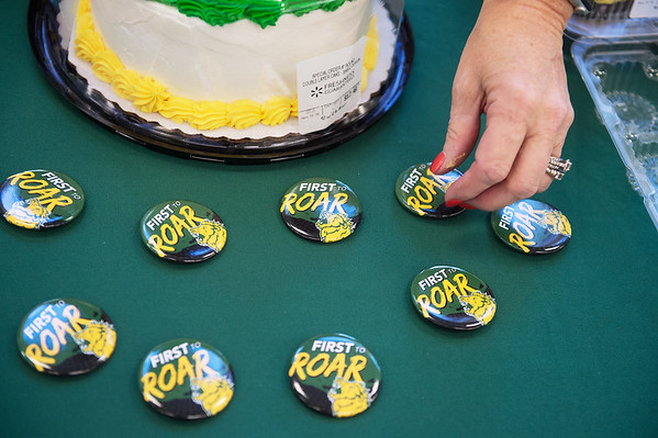 Debbie Fort, director of Project Stay, puts out buttons for First Gen Day at Missouri Southern on Friday.<br /> Globe | Roger Nomer