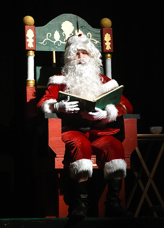 "Carter Brower portrays Santa during rehearsals for the Webb City High School production of ""Elf,"" which opens Thursday night at WCHS. The cast and crew are collecting toys to benefit children.<br /> Globe 
