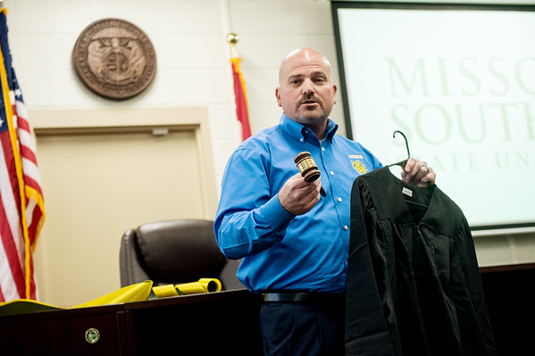 Tim Wilson, department chair for criminal justice at Missouri Southern State University, talks about the contents of the mock courtroom at MSSU on Tuesday.<br /> Globe   Roger Nomer