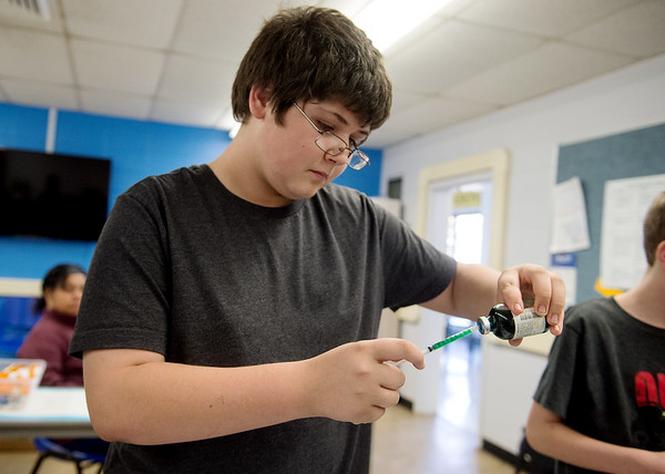 Dennis Schartz III, eighth grader at Neosho Junior High School, practices drawing an injection on Tuesday at the Dell Reed Technical Education Center at Crowder College.<br /> Globe | Roger Nomer