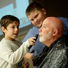 Jack Delman, left, and JJ Curry, fifth graders at Cecil Floyd Elementary, shave David Culbertson, fourth-grade teacher, on Tuesday at the school. Cecil Floyd students raised $1,000 for Children's Haven during a fundraiser for No Shave November. They also voted on the faculty member they wanted to see shaved at the assembly, with Culbertson being the lucky winner.<br /> Globe | Roger Nomer