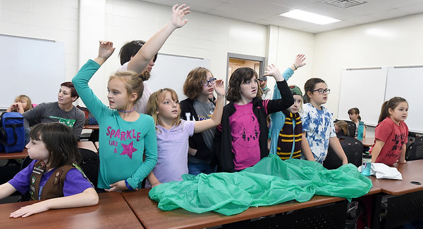 Area Girl Scouts answer questions about hidden objects during the Missouri Southern Women in Science Club's STEM event for area scouts.<br /> Globe | Lurie Sisk