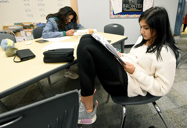 From the left: Pooja Nusariwala and Keya Pandy take practice ACT tests in reading on Wednesday during an ACT test prep class at Joplin High School.<br /> Globe | Laurie Sisk