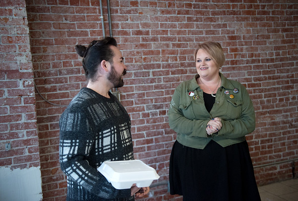 Topher Layton, an alumi actor of the Dream Theatre Co., talks with Becki Arnall, founder of Dream Theatre Co., about the potential black box theater space in downtown Joplin on Friday.<br /> Globe | Roger Nomer