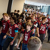 Members of the Joplin High football team walk through the school during a parade on Tuesday afternoon.<br /> Globe | Roger Nomer