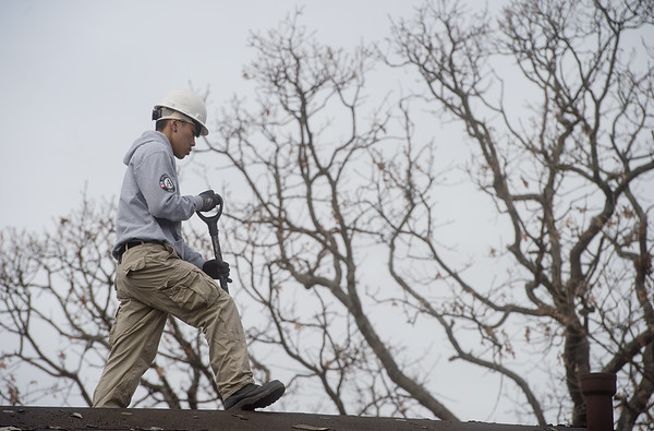 Jet Lee, from Sacramento, Calif., works on a roof at Royal Heights Baptist Church on Monday during an Americorps project.<br /> Globe | Roger Nomer