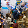 Kate Tupper, second-grade teacher at Royal Heights Elementary, reads to students with Maple on Tuesday at the school.<br /> Globe | Roger Nomer