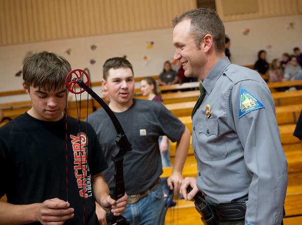Scott Brown, Barton County conservation agent, talks with Case Hampton, left, and Theodore Crabtree, juniors at Liberal High School, on Wednesday.<br /> Globe | Roger Nomer