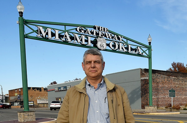 Miami Mayor Rudy Schulz stands near the town's historic Gateway sign on Main Street on Thursday. Some Oklahoma state lawmakers are proposing changing the name of a stretch of historic Route 66 to Donald Trump Highway.<br /> Globe | Laurie Sisk