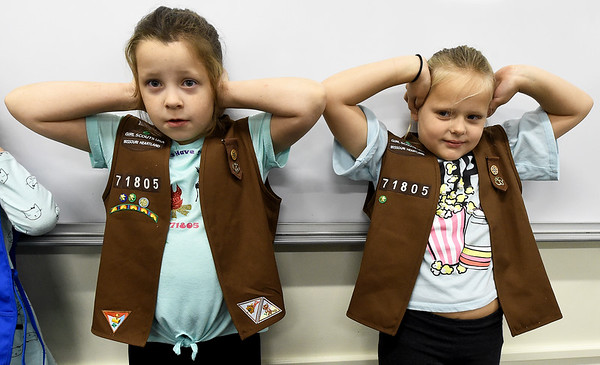 From the left: Violet Snider, 7 and Piper Hill, 8, from Troop 71805 of Pittsburg, shield their ears as they wait for their turn in an observation exercise during the Missouri Southern Women in Science Club's STEM event for area scouts.<br /> Globe | Lurie Sisk