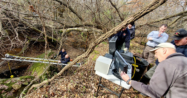Officials checking a mineshaft in Picher to see if it's safe to put divers in to search for the Welch girls.  Gary Crow/JOPLIN GLOBE