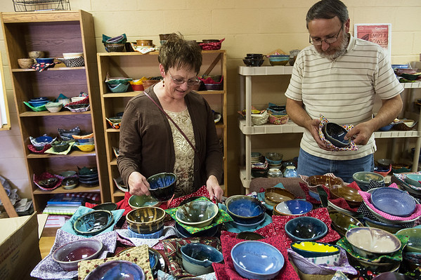 Susan and Nelson Horton pick out their empty bowls during a presale for the fundraiser on Monday at The Forge in Joplin.<br /> Globe | Roger Nomer