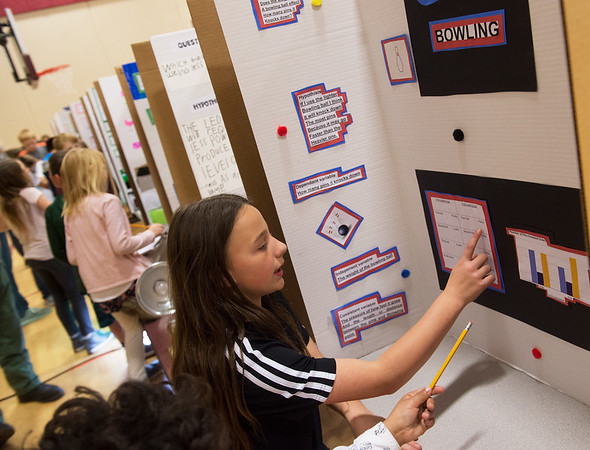 Kristie Lynn, fifth grader at Jefferson Elementary, talks about her science project on bowling ball weight during Monday's Science Fair at Jefferson Elementary.<br /> Globe   Roger Nomer