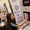 Kristie Lynn, fifth grader at Jefferson Elementary, talks about her science project on bowling ball weight during Monday's Science Fair at Jefferson Elementary.<br /> Globe | Roger Nomer