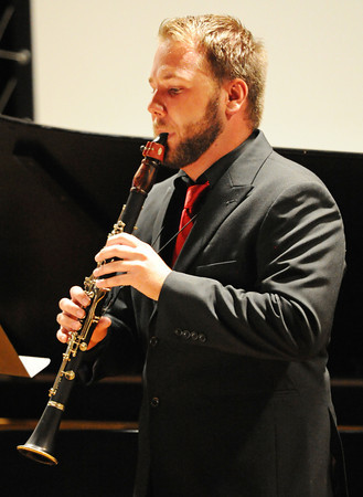 "Preston Besett plays ""Introduction, Theme and Variations"" by Rossini on the clarinet during the Wednesday evening, Oct. 2, 2013, musical event for MSSU's Italy semester at Webster Hall's Corely Auditorium. Globe 