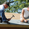 Carl Junction volunteers Richard Smith (left) and son Bryan Smith work on the roof of a new pavillion/shelter at Carl Junction's Memorial Park Thursday morning, Oct. 10, 2013.<br /> Globe | T. Rob Brown