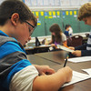 Globe/Roger Nomer<br /> Kaiden Seaman, left, and Jonathan Matarazzo, third graders at West Central Elementary, work on animal research projects on Wednesday.