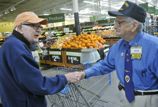 Globe/Roger Nomer<br /> Jim Metz, Joplin, left, chats with Keith Fiscus at the 15th Street Wal-Mart on Wednesday.
