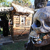 A paper meche skull created by Jay Olson for his annual Halloween display oversees his handywork as Olson works on a witch's shack on Wednesday evening, Oct. 9, 2013, outside Olson's Baxter Springs, Kan., home.<br /> Globe | T. Rob Brown