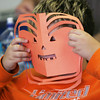 Globe/Roger Nomer<br /> Garrett Gettler, fourth grade, holds up a pumpkin mask while working on an art project at St. Mary's in Pierce City on Tuesday.