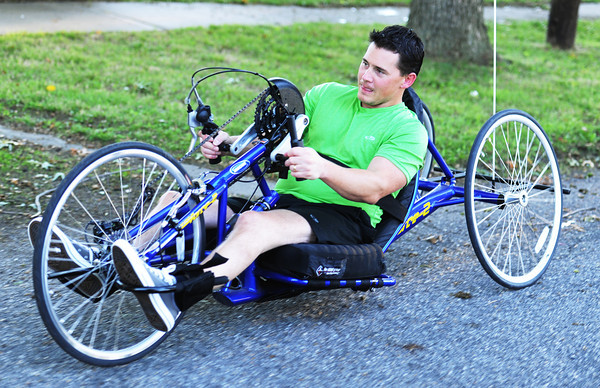Brian Smith, a paraplegic preparing for the Mother Road Marathon, rides down a road Wednesday evening, Oct. 9, 2013, near his Baxter Springs, Kan., home.<br /> Globe | T. Rob Brown