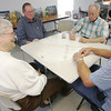 Globe/Roger Nomer<br /> (from bottom left) Kay Smither, James Heger, Bud Johnson and Jim Peck play a game of dominos at the Joplin Senior Center on Wednesday.