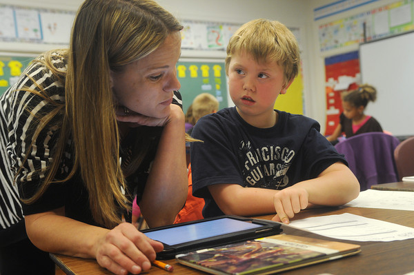 Globe/Roger Nomer<br /> Dominic Combs, a third grader at West Central Elementary, works on an animal research project with his teacher Carrie Doll on Wednesday.