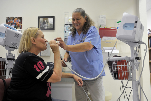 Globe/Roger Nomer<br /> Jane Fillmore, a RMA at the community clinic, checks the vitals of Donna Dame, Diamond, on Tuesday morning.