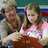 Globe/Roger Nomer<br /> Diana Milburn helps Katie Doss, fourth grade, with an art project at St. Mary's in Pierce City on Tuesday.