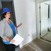 Globe/Roger Nomer<br /> During a tour on Monday, Liz Erickson, development coordinator at Children's Haven, shows the front rooms of the new facility being built next to the current Children's Haven building.