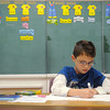 Globe/Roger Nomer<br /> Truman Oaks, a third grader at West Central Elementary, works on an animal research poster in class on Wednesday.